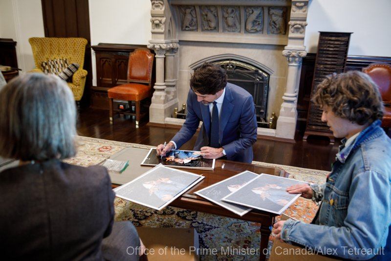 The Prime MInister signs images for me